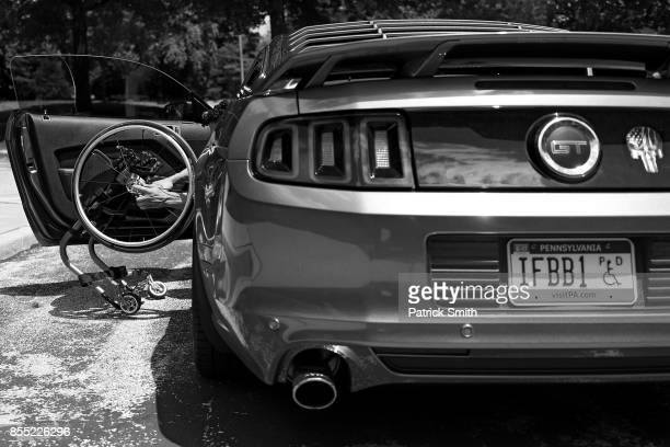 Pro Wheelchair Bodybuilder Johnny Quinn assembles his wheelchair after arriving home from church at his home on July 16 2017 in Chesterbrook...