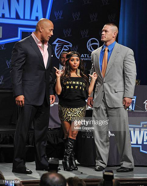 Pro wrestler Dwayne 'The Rock' Johnson television personality Nicole 'Snooki' Polizzi and pro wrestler John Cena attend the WrestleMania XXVII press...