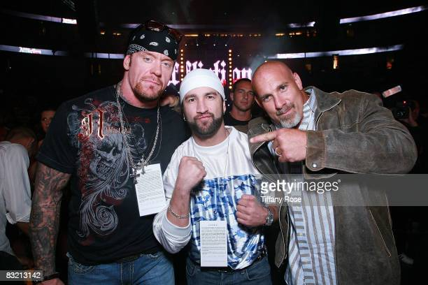 Pro Wrestler Mark 'The Undertaker' Calaway Fighter Gregory Helms and Pro Wrestler Stone Cold Steve Austin attend the Affliction Banned at the Honda...