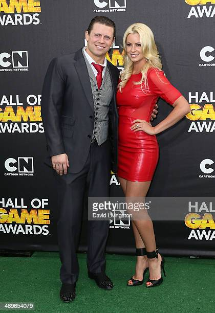 Pro wrestler The Miz and fiancee Maryse Ouellet attend Cartoon Network's Hall of Game Awards at Barker Hangar on February 15 2014 in Santa Monica...