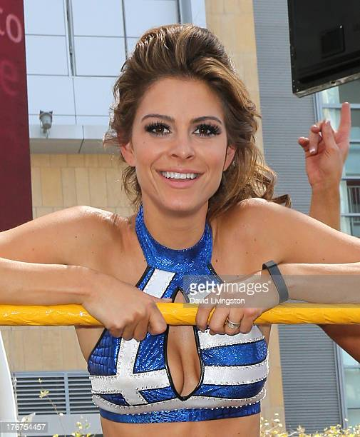 Pro wrestler/journalist Maria Menounos poses at WWE and E's Total Divas takeover of SummerSlam at Nokia Plaza LA LIVE on August 18 2013 in Los...