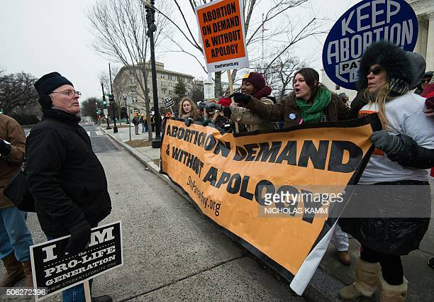 Proabortion activists argue with a prolife demonstrator in front of the US Supreme Court in Washington DC 0n January 22 2016 as the country marks the...