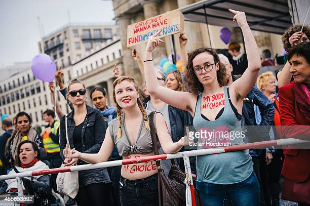 Proabortion protesters demonstrate with 'My body my choice' written on their bodies in front of Brandenburg Gate during their counterdemonstration...