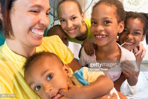 Santa Domingo Dominican Republic November 30 2012 Probably a family scene with a mother and five young children in the poor neighbourhood 'Los...