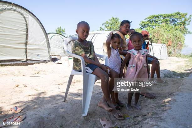 PortauPrince Haiti December 09 2012 Probably a family with young children are sitting on plastic chairs in Close up at the string that stabilize a...