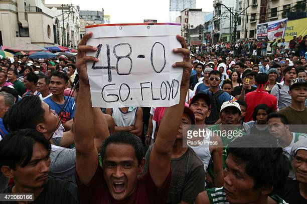 Probably the only Mayweather fan in Quiapo Manila as he raises a poster signifying Mayweather's flawless record Hundreds of people watched the...