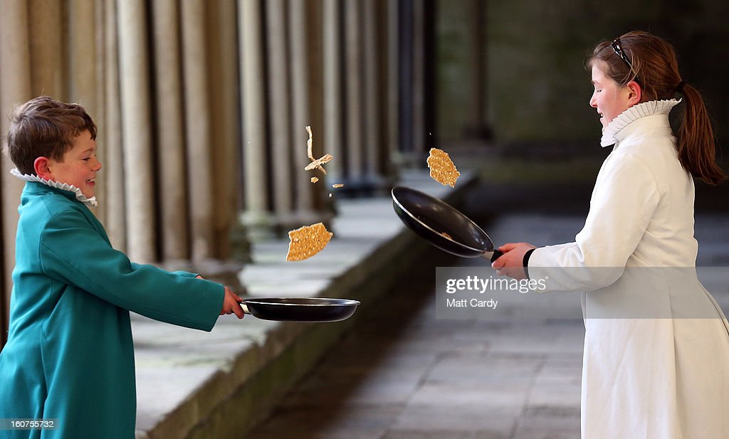 Probationers from Salisbury Cathedral Choir flips a pancake at Salisbury Cathedral on February 5, 2013 in Salisbury, England. The trainee choristers had to celebrate and learn about Shrove Tuesday a week early as they will be on half-term on pancake day next week. Every year the choristers make pancakes to learn about the meaning of Shrove Tuesday, which is traditionally the day that all fats and flesh are eaten up to prepare for the forty days fast of Lent.