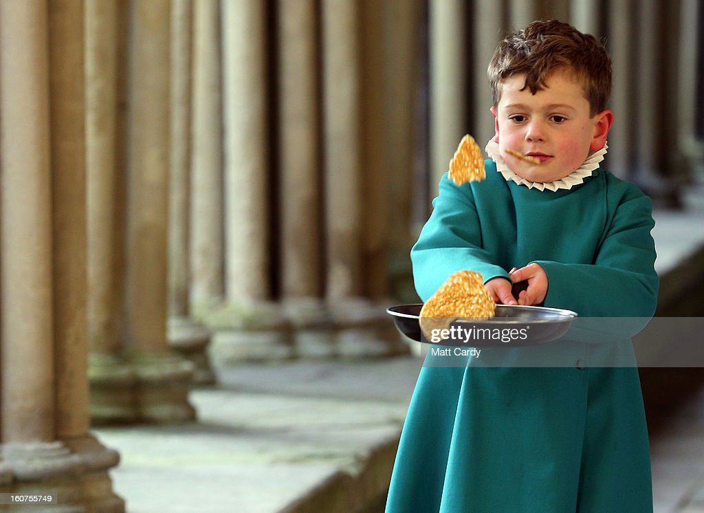 A probationers from Salisbury Cathedral Choir flips a pancake at Salisbury Cathedral on February 5, 2013 in Salisbury, England. The trainee choristers had to celebrate and learn about Shrove Tuesday a week early as they will be on half-term on pancake day next week. Every year the choristers make pancakes to learn about the meaning of Shrove Tuesday, which is traditionally the day that all fats and flesh are eaten up to prepare for the forty days fast of Lent.