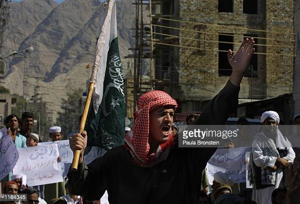 A proBin Laden demonstrator takes part in a peaceful small protest after Friday prayers September 29 2001 in Quetta Pakistan