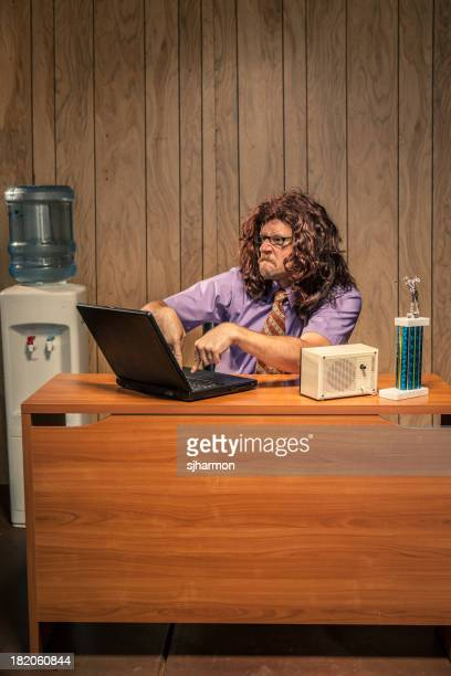 Problematic Work Place Scene with Shaggy Haired IT Computer Guy