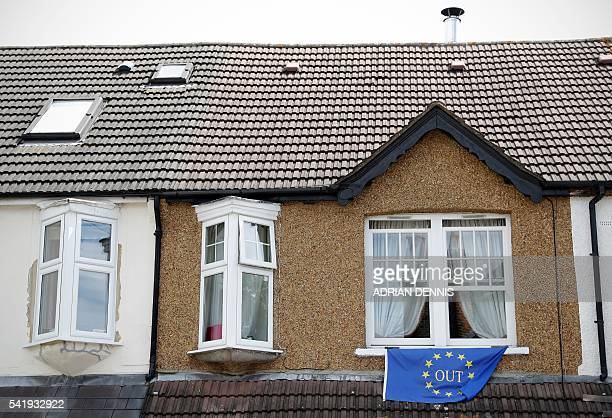 A proBrexit flag is attached to a window of a house in Carshalton south of London on June 21 2016 Britain goes to the polls in two days to vote on...