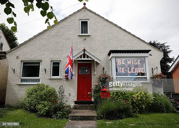 A proBrexit message is seen in the window of a house in Carshalton south of London on June 21 2016 Britain goes to the polls in two days to vote on...