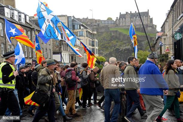 ProCatalonia demonstrators march through the West End of Edinburgh with Edinburgh Castle in the background on the day Catalonia attempted to hold a...