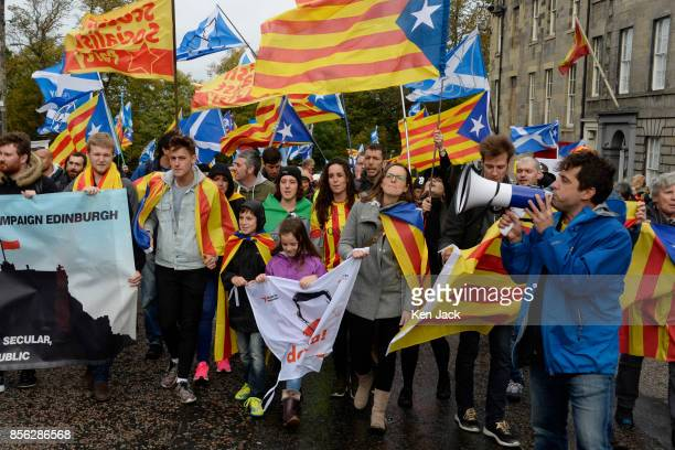 ProCatalonia demonstrators march through the West End of Edinburgh to the European Commission offices on the day Catalonia attempted to hold a...