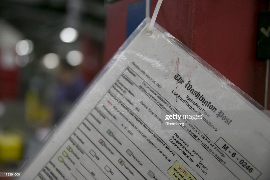 A procedure checklist hangs in the run of press area of the Washington Post newspaper production facility in Springfield, Virginia, U.S., on Friday, July 12, 2013. The Washington Post began publishing on Thursday, Dec. 6, 1877, and had a circulation of 10,000. The newspaper contained four pages and cost three cents a copy. Photographer: Andrew Harrer/Bloomberg via Getty Images