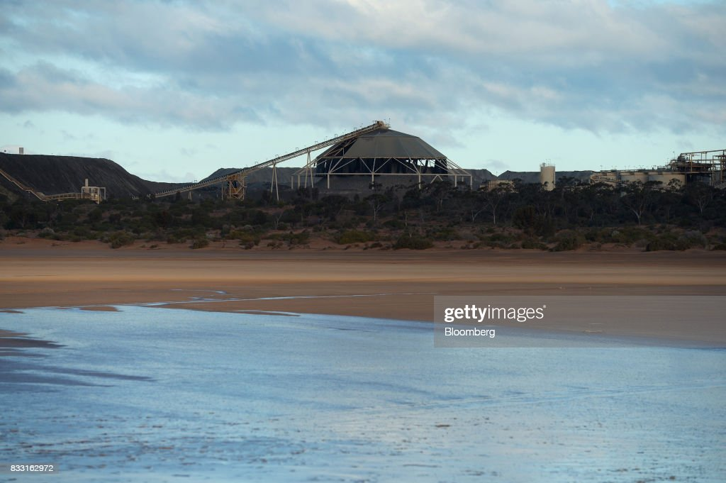 A processing plant stands beyond Lake Lefroy at the St Ives Gold Mine operated by Gold Fields Ltd. in Kambalda, Australia, on Wednesday, Aug. 9, 2017. Global gold deals have also slowed, declining to $19.8 billion in 2016 from $22.8 billion a year earlier, according to data complied by Bloomberg.Photographer: Carla Gottgens/Bloomberg via Getty Images