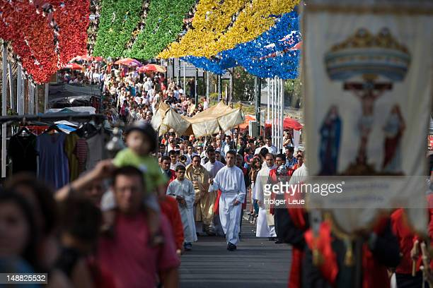 Procession at festival honoring patron saint.