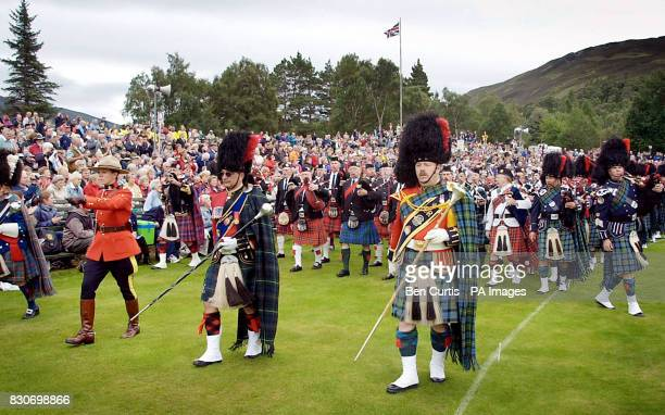A procession of Canadian pipers march around the arena at the Braemar Games in Royal Deeside Scotland The Braemar Gathering has been seen as...