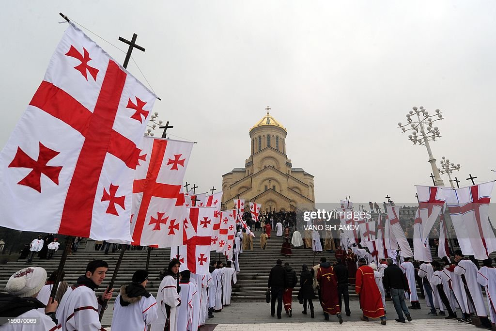 A procession of Georgian believers arrives at the Tbilisi cathedral on January 7, 2013 during the Christmas celebrations. Orthodox Christians celebrate Christmas on January 7 in the Middle East, Russia and other Orthodox churches that use the old Julian calendar instead of the 17th-century Gregorian calendar adopted by Catholics, Protestants, Greek Orthodox and commonly used in secular life around the world.