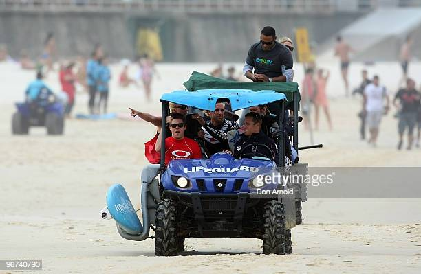 A procession of photographers and various media follow Zac Efron as he makes his way down Bondi Beach in a beach buggy as he attends Oakley's 'Learn...