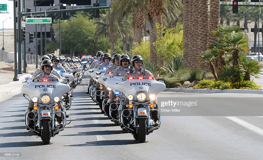 A procession of police officers on motorcycles arrives at the funeral for Las Vegas Metropolitan Police Department Officer Alyn Beck at The Smith Center for the Performing Arts on June 14, 2014 in Las Vegas, Nevada. Police said Beck and Officer Igor Soldo were shot and killed on June 8 at a restaurant by Jerad Miller and his wife Amanda Miller. Police said the Millers then went into a nearby Wal-Mart where Amanda Miller killed Joseph Wilcox before police killed Jerad Miller and Amanda Miller killed herself.