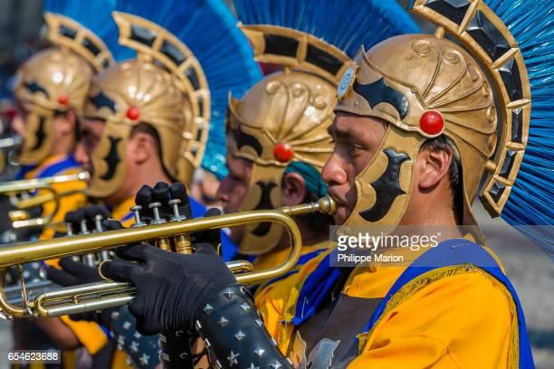 A procession of Roman trumpet players at a parade during Holy Week (Semana Santa) Antigua, Guatemala