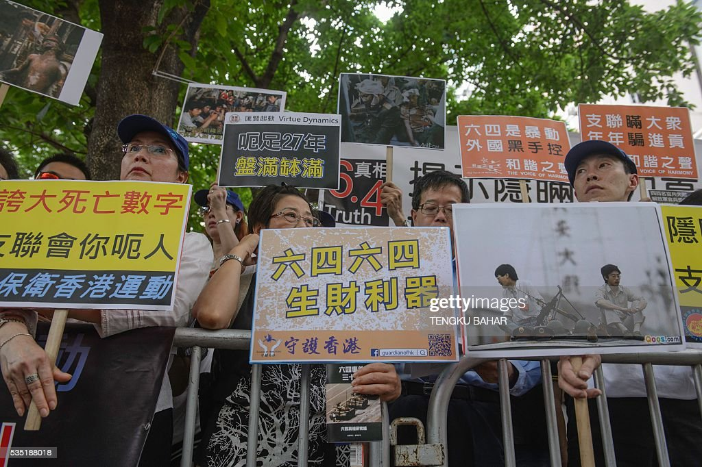 Pro-China demonstrators hold placards in a counter-protest against a pro-democracy rally ahead of the anniversary of the June 4, 1989 Tiananmen Square crackdown, in Hong Kong on May 29, 2016. People will gather in Hong Kong on June 4 for the annual remembrance ceremony to mark the 27th anniversary of the Tiananmen Square crackdown. / AFP / TENGKU