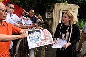 ProChina protesters present a letter to a representative from Hong Kong's United States Consulate as they protest against the ruling by the Permanent...