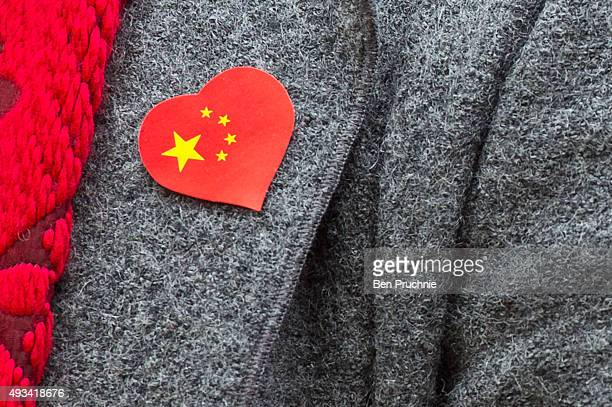 ProChina supporter wears a sticker with the Chinese flag on during a counter protest held nearby Amnesty International who are protesting against...