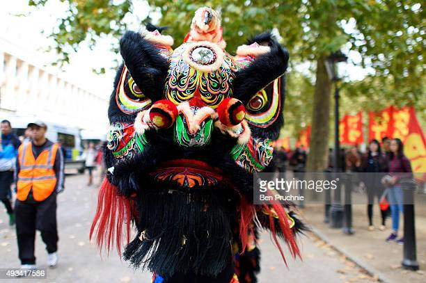 ProChina supporters perform a dragon dance infront of supporters of Amnesty International who are protesting against claims of a deterioration in...
