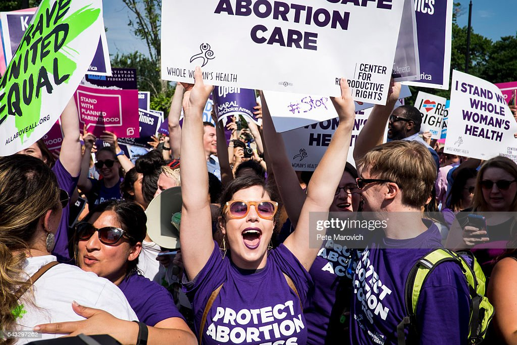 Pro-choice activists celebrate on the steps of the United States Supreme Court on June 27, 2016 in Washington, DC. In a 5-3 decision, the U.S. Supreme Court struck down one of the nation's toughest restrictions on abortion, a Texas law that women's groups said would have forced more than three-quarters of the state's clinics to close.