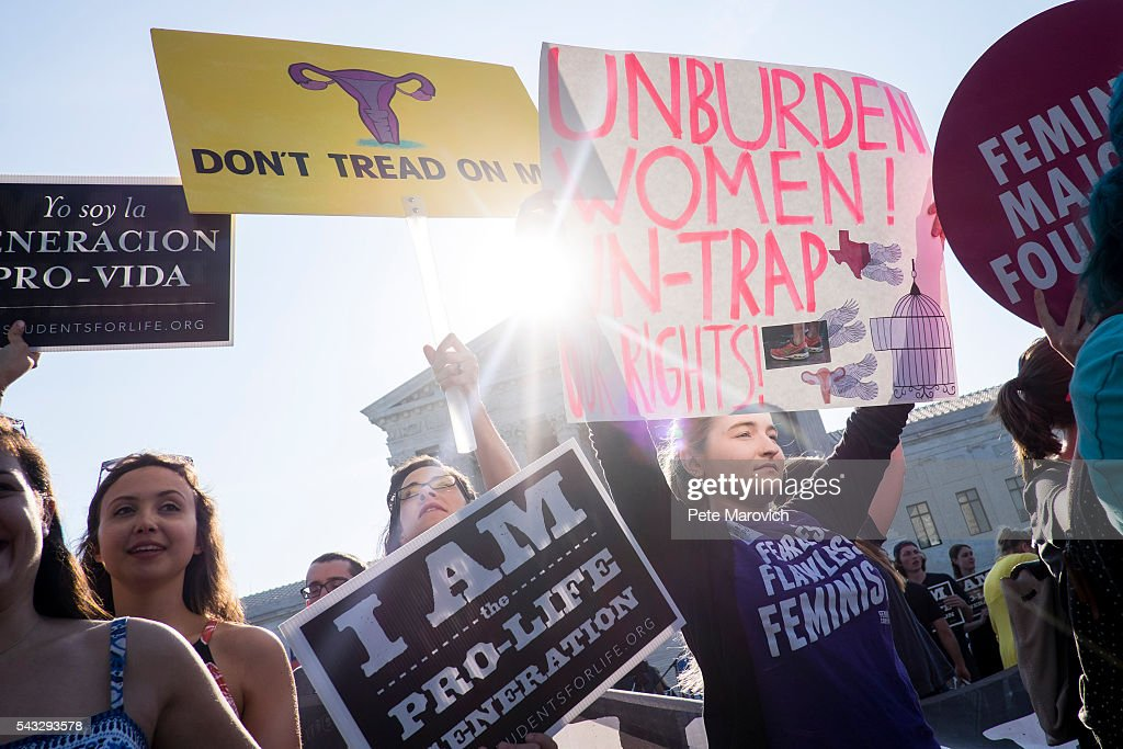 Pro-choice activists wait for rulings in front of the U.S. Supreme Court on June 27, 2016 in Washington, DC. A ruling is expected in Whole Woman's Health v. Hellerstedt, a Texas case the places restrictions on abortion clinics, as well as rulings in the former Virginia Governor's corruption case and a gun rights case.