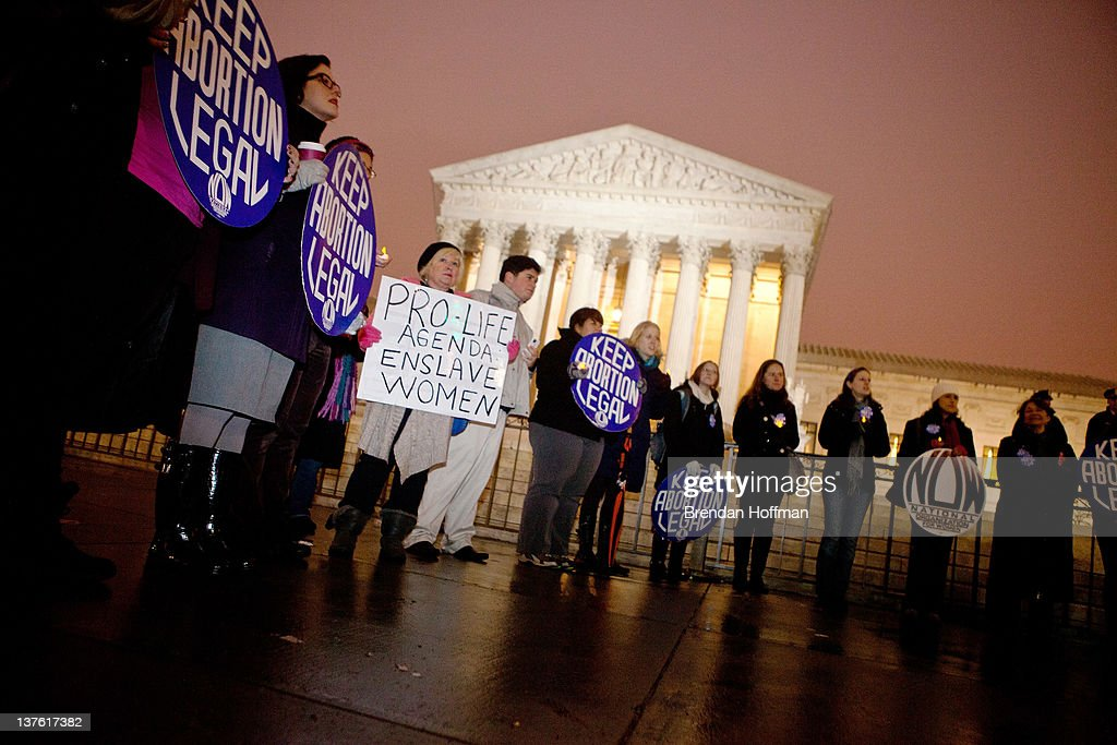 Pro-choice activists with the National Organization For Women hold a vigil outside the U.S. Supreme Court on January 23, 2012 in Washington, DC. The vigil was held to mark the anniversary of the Roe v. Wade Supreme Court decision that legalized abortion.