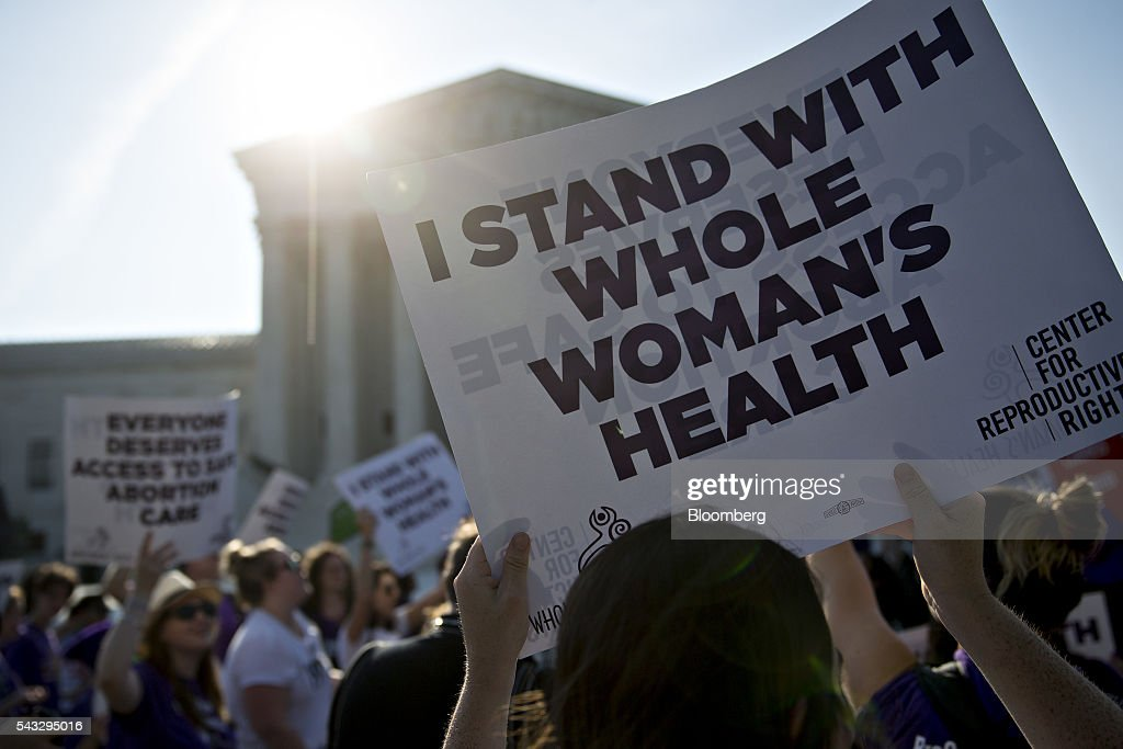 A pro-choice advocate holds a sign outside the U.S. Supreme Court before rulings in Washington, D.C., U.S., on Monday, June 27, 2016. A divided U.S. Supreme Court struck down a Texas law that had threatened to close three-quarters of the states abortion clinics by putting new requirements on facilities and doctors. Photographer: Andrew Harrer/Bloomberg via Getty Images