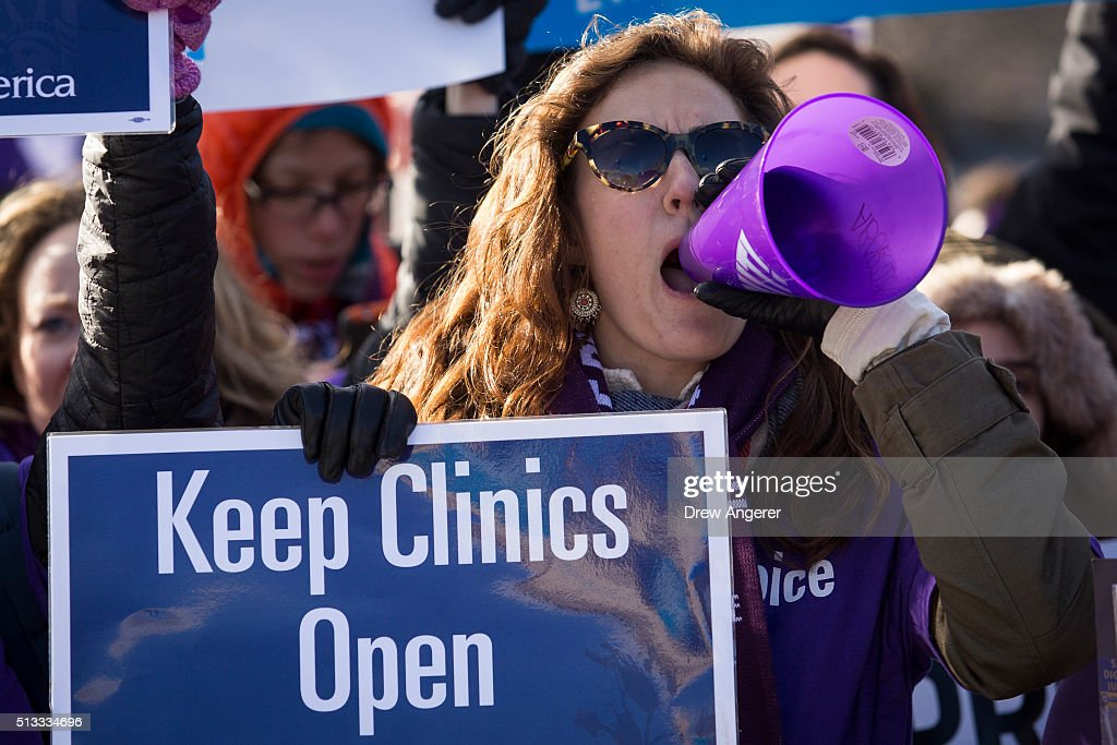 Pro-choice advocates rally outside of the Supreme Court, March 2, 2016 in Washington, DC. On Wednesday morning, the Supreme Court will hear oral arguments in the Whole Woman's Health v. Hellerstedt case, where the justices will consider a Texas law requiring that clinic doctors have admitting privileges at local hospitals and that clinics upgrade their facilities to standards similar to hospitals.