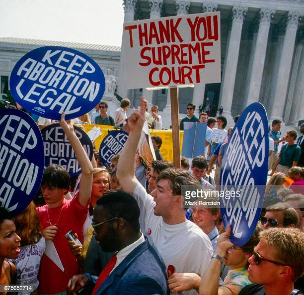 Prochoice and antiabortion demonstrators stage concurrent events outside the United States Supreme Court Building Washington DC April 26 1989 The...