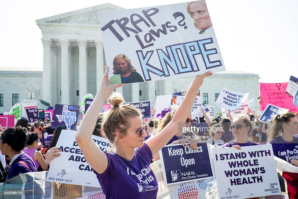 Pro-choice and pro-life activists demonstrate on the steps of the United States Supreme Court on June 27, 2016 in Washington, DC. In a 5-3 decision, the U.S. Supreme Court struck down one of the nation's toughest restrictions on abortion, a Texas law that women's groups said would have forced more than three-quarters of the state's clinics to close.