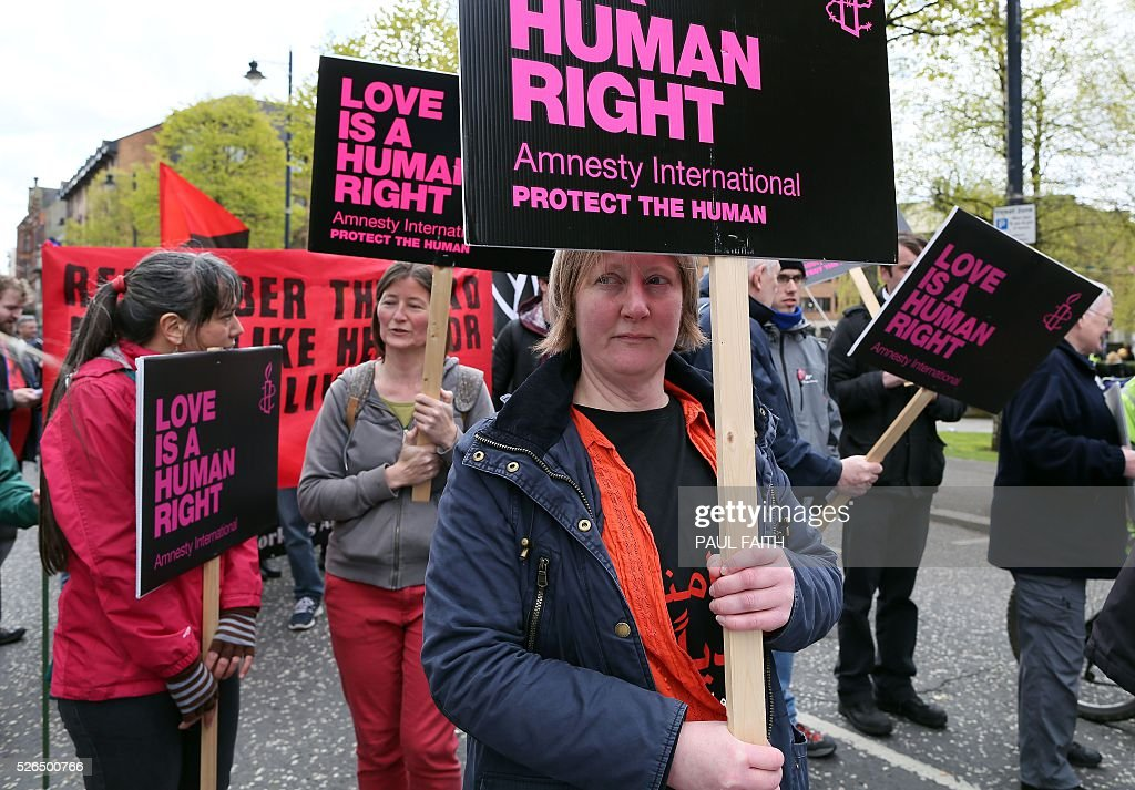 Pro-choice campaigners take part in a demonstration through Belfast city centre on April 30, 2016. Abortion prosecutions in Northern Ireland have forced the issue to centre of the campaign ahead of next week's regional elections, with unprecedented political support for an end to the current ban. Northern Ireland currently bans abortion in all cases except when the life of the mother is in danger / AFP / PAUL
