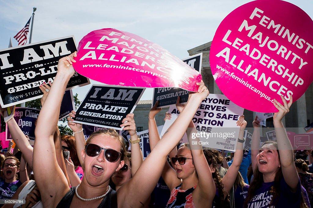 Pro-choice demonstrators at the U.S. Supreme Court cheer as they learn the court struck down the Texas abortion law on Monday, June 27, 2016.