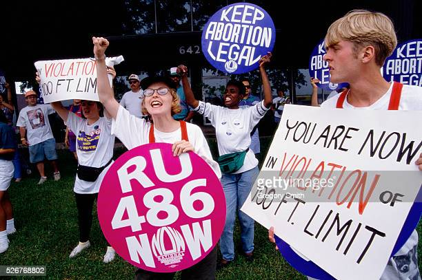 Prochoice demonstrators rally outside Planned Parenthood headquarters in Houston Texas One woman holds a sign reading 'RU 486 NOW' promoting the...