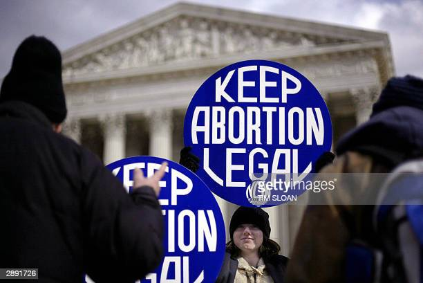 Prochoice supporter and intern with the National Organization for Women Meredith Harper smiles as she ignores the pleadings of prolife protesters...