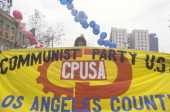 Procommunist marchers holding banner Los Angeles California
