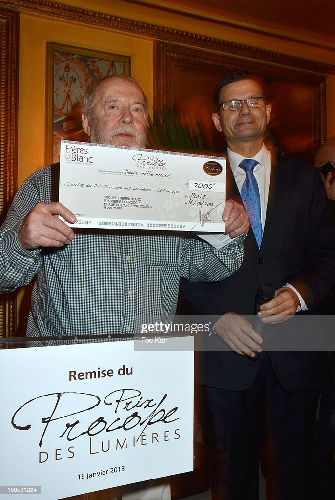 'Procope des Lumieres 2013' recipient writer Clement Rosset and the 'Groupe des Freres Blanc' representative attend the 'Procope Des Lumieres 2013 ' Literary Awards Ceremony at Le Procope on January 16, 2013 in Paris, France.