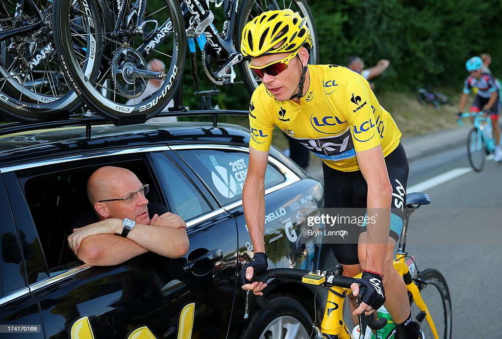 Procycling General Manager Sir <a gi-track='captionPersonalityLinkClicked' href=/galleries/search?phrase=Dave+Brailsford&family=editorial&specificpeople=3000000 ng-click='$event.stopPropagation()'>Dave Brailsford</a> speaks with the winner of the 2013 Tour de France, <a gi-track='captionPersonalityLinkClicked' href=/galleries/search?phrase=Chris+Froome&family=editorial&specificpeople=5428054 ng-click='$event.stopPropagation()'>Chris Froome</a> of Great Britain and SKY during the twenty first and final stage of the 2013 Tour de France, a processional 133.5KM road stage ending in an evening race around the Champs-Elysees, on July 21, 2013 in Paris, France.