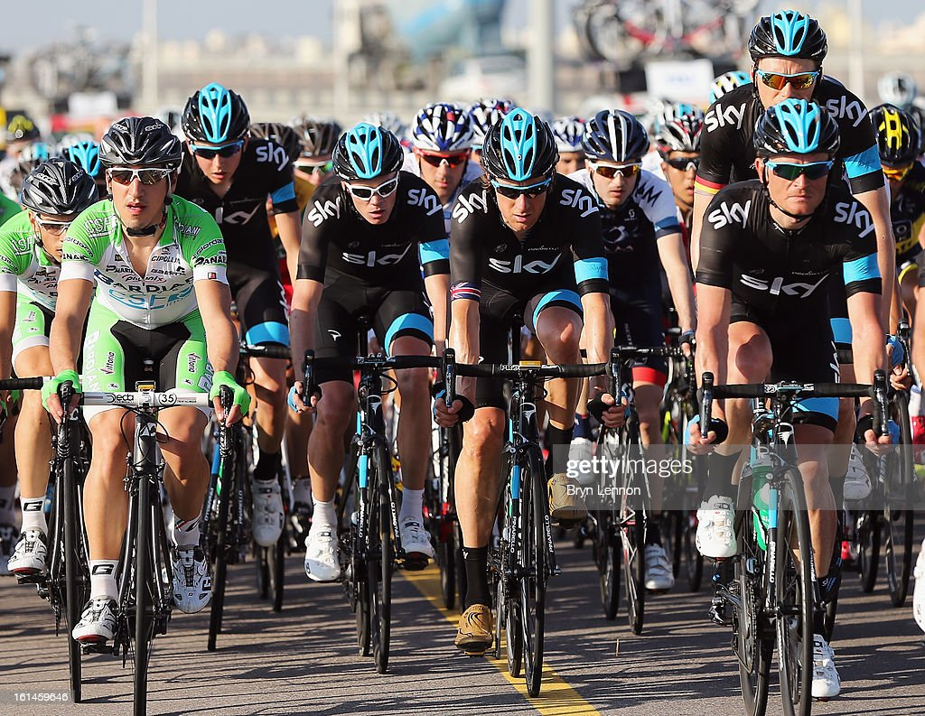 Procycling riders Chris Froome of Great Britain and Sir Bradley Wiggins ride in the peloton during stage one of the 2013 Tour of Oman from Al Musannah to Sultan Qaboos University on February 11, 2013 in Muscat, Oman.