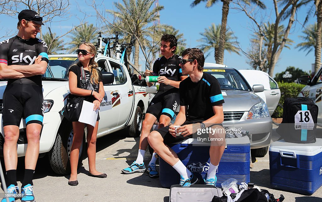 SKY Procycling riders Gabriel Rash, <a gi-track='captionPersonalityLinkClicked' href=/galleries/search?phrase=Geraint+Thomas&family=editorial&specificpeople=804304 ng-click='$event.stopPropagation()'>Geraint Thomas</a> and Luke Rowe sign autgraphs for a young fan at the start of stage six of the 2013 Tour of Qatar from Sealine Beach Resort to Doha Corniche on February 8, 2013 near Sealine Beach Resort, Qatar.