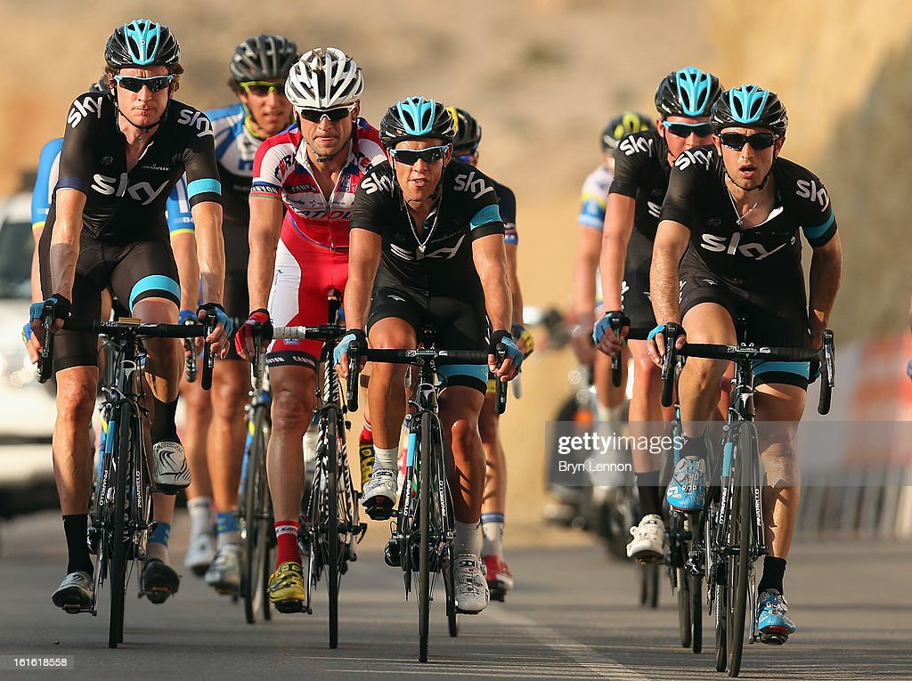 Sir Bradley Wiggins of Great Britain, Richie Porte of Australia and Dario Cataldo of Italy crosses the finishline on stage three of the 2013 Tour of Oman from Nakhal Fort to Wadi Dayqah Dam on February 13, 2013 in Wadi Dayqah Dam, Oman.