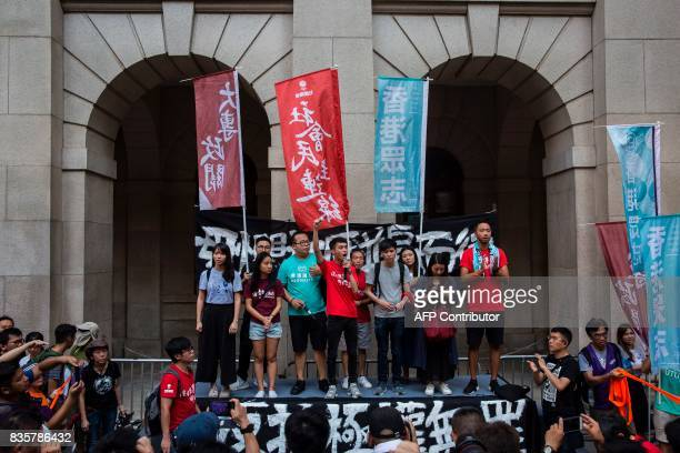 Prodemocracy activist address the crowd outside the Court of Final appeal after marching in Hong Kong on August 20 to protest the jailing of Joshua...