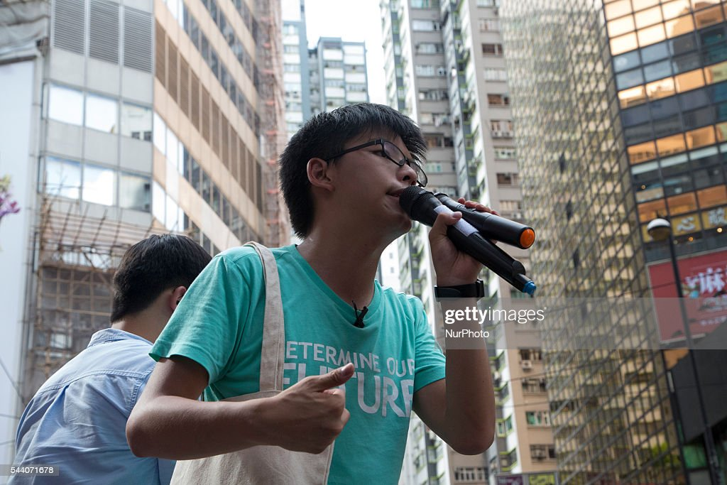 Pro-Democracy activist Joshua Wong shouts slogan during the march in Hong Kong, July 1 2016. Pro Democracy protesters march as the city marks the 19th anniversary of the handover from Uk to China.