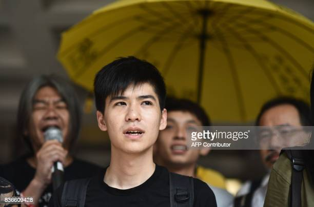 TOPSHOT Prodemocracy activist Lester Shum chants slogans before entering the High Court to defend against the charge of contempt of court in Hong...